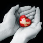 wounded heart in hands
